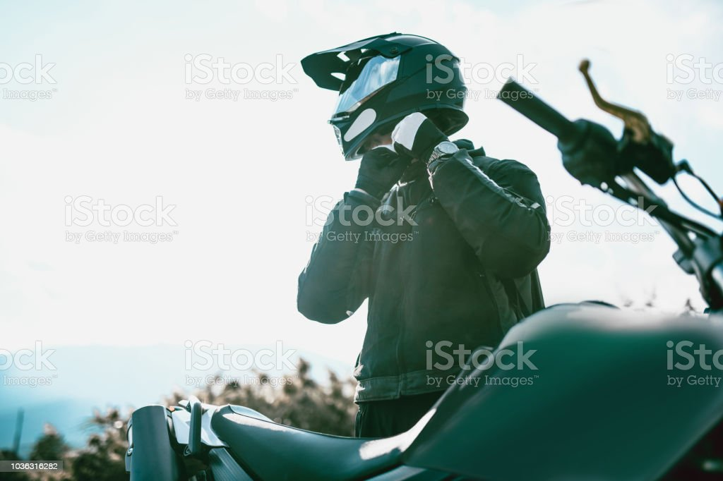 Motorcyclist With Specialized Equipment Getting Ready To Ride stock photo