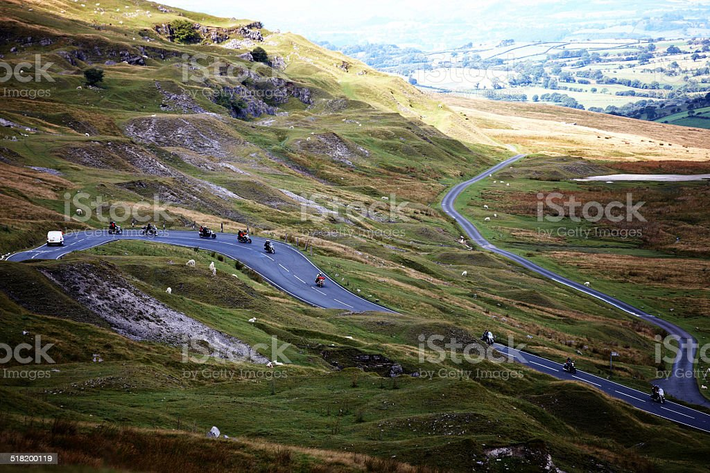 Motorcyclists on meandering Brecon Beacons road stock photo