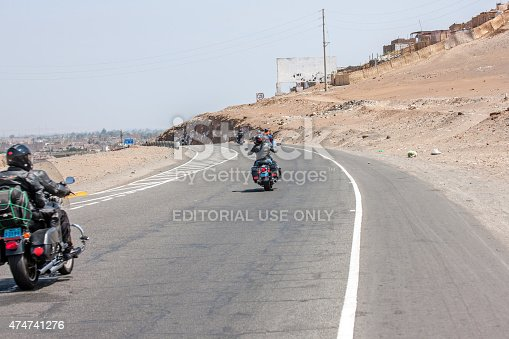 Huaral, Peru - January 22, 2015: Harley Davidson Motorcyclists in convoy on the pan-american highway in Peru