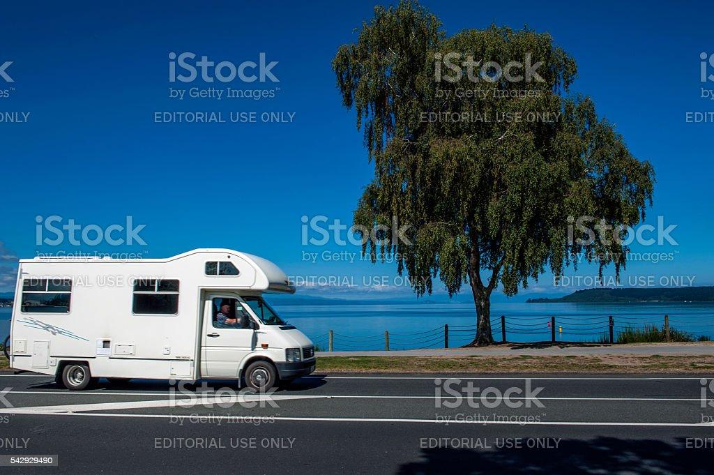 Motorhome driving along Lake Taupo, New Zealand stock photo