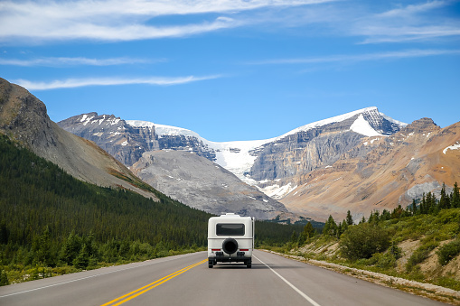 A motorhome making it's way through the Rocky Mountains in Jasper National Park