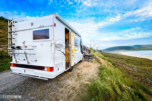 istock Motorhome RV and campervan are parked on a beach. 1177173576