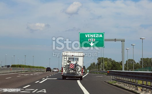 istock motorhome traveling on the highway towards Venice in the summer 1053366494