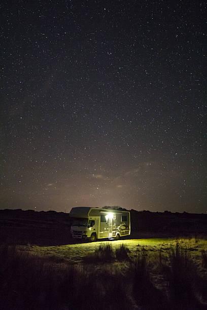 Motorhome under the stars stock photo