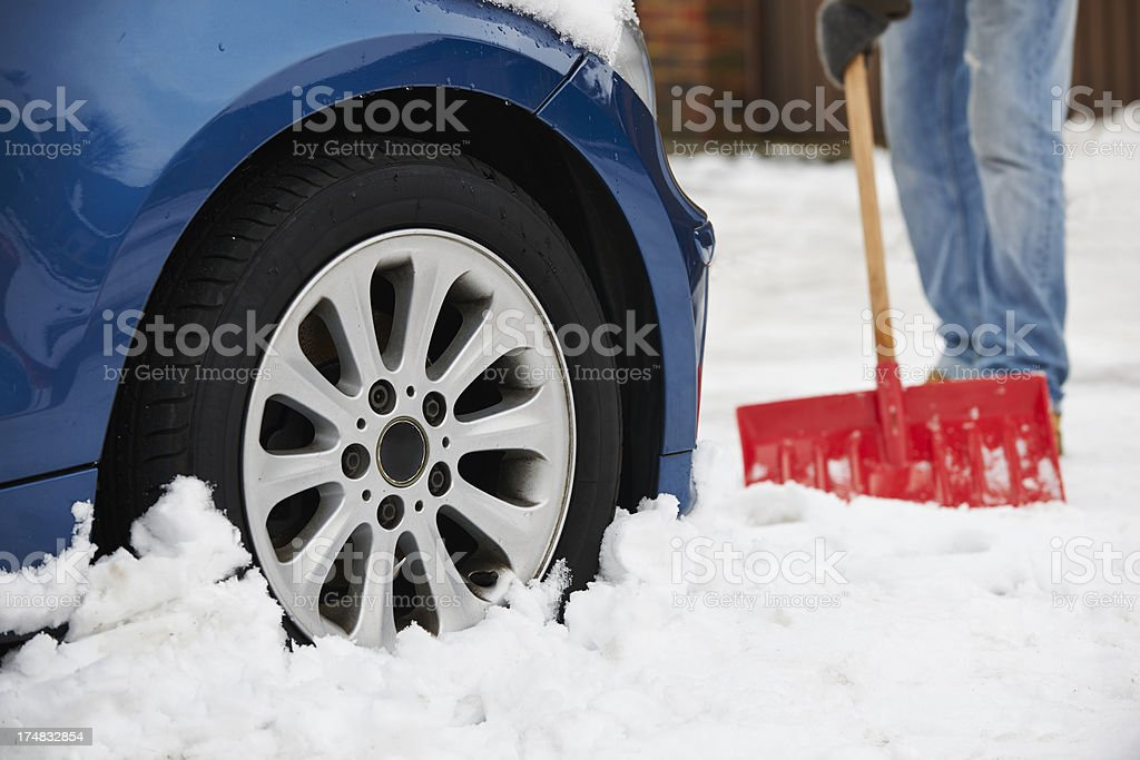 Motorist Digging Car Out Of Snow royalty-free stock photo