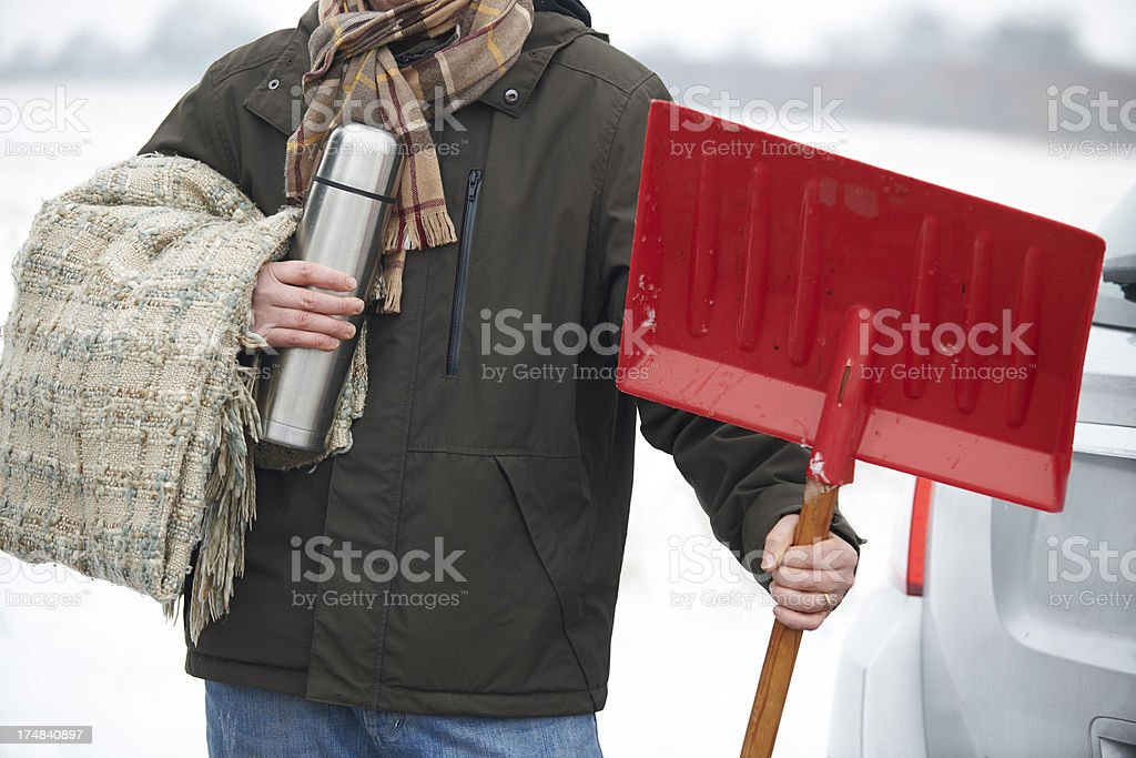 Motorist Holding Blanket And Thermos In Case Of Winter Breakdown stock photo