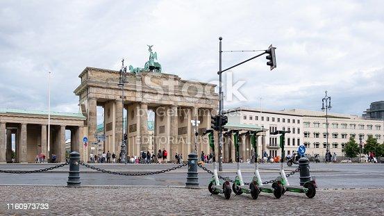 BERLIN, GERMANY - JULY 8, 2019: Motorized Electric Scooters At Brandenburg Gate In Berlin, Germany In Summer