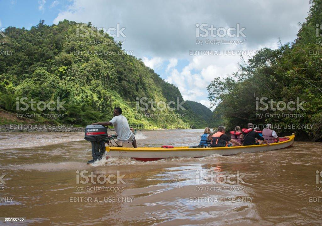 Motorized Longboat Ride stock photo