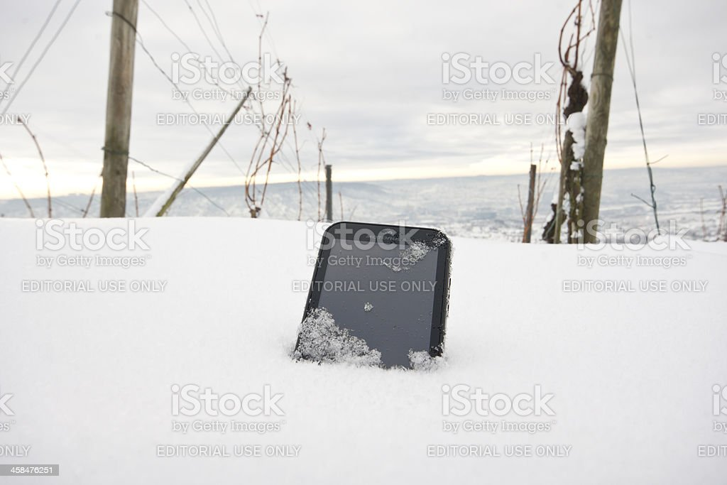 Motorola Defy in snow royalty-free stock photo