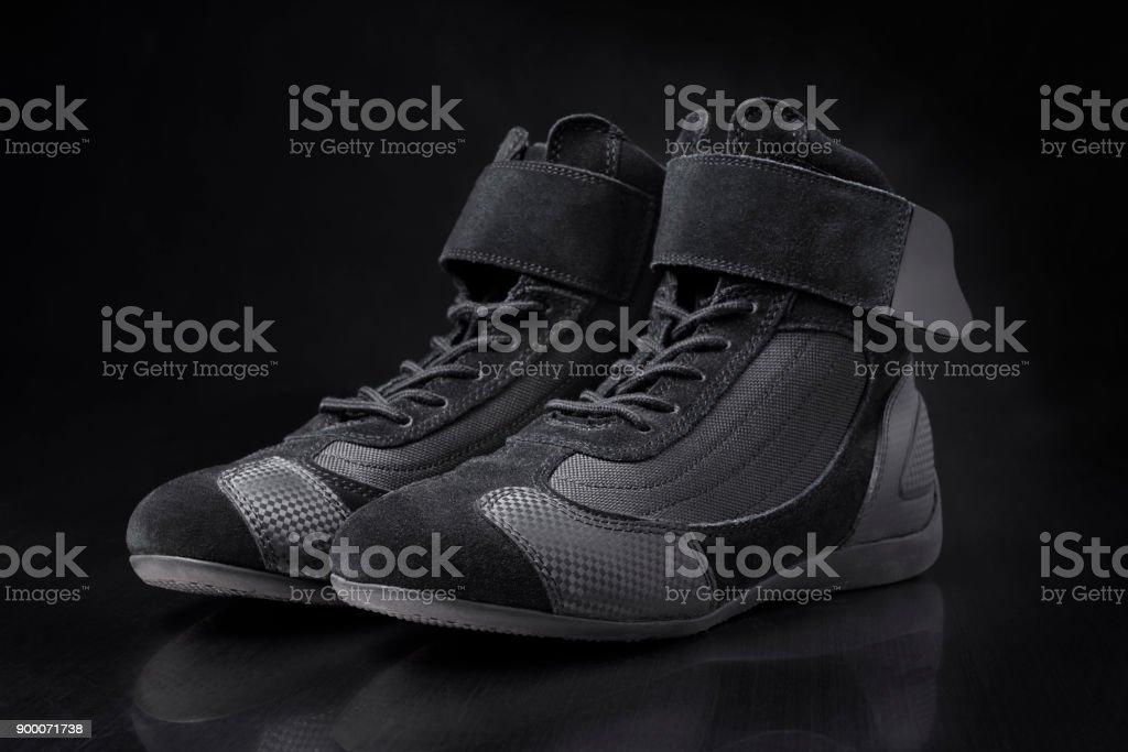 Black racing shoes for motorsport racing