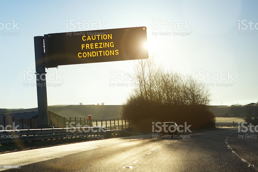 Motorway gantry sign in winter stock photo