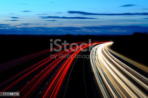 A wide angle view of motorway lights under a dusk sky. XL image size.