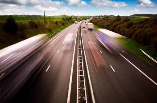 Traffic streaks on a busy French motorway