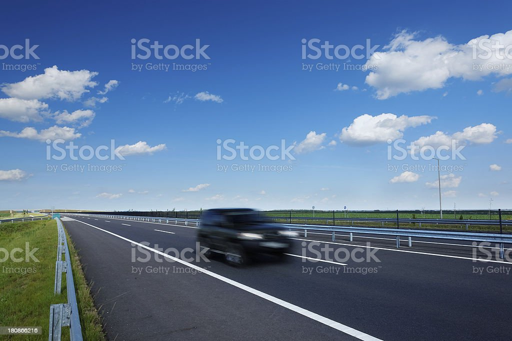 motorway with a motion blurred car stock photo