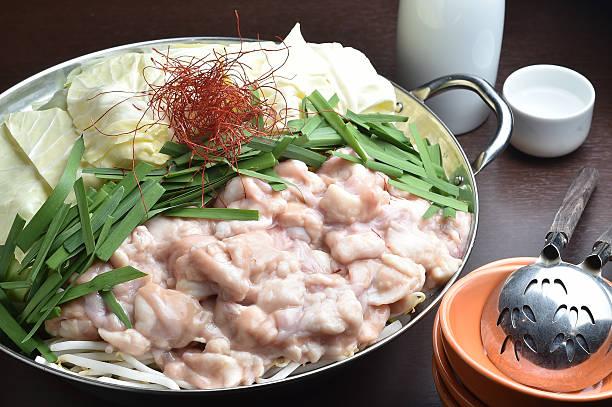 motsunabe, or giblets cooked in a hot pot - innereien stock-fotos und bilder