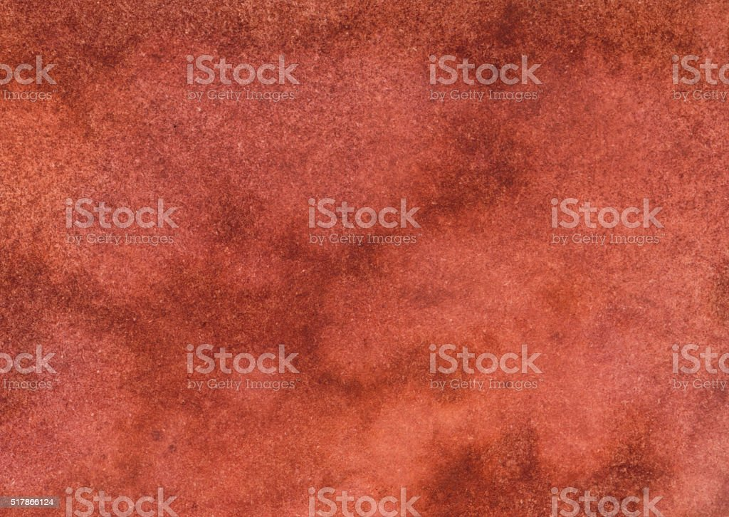 Mottled distressed background with shades of orange rust stock photo