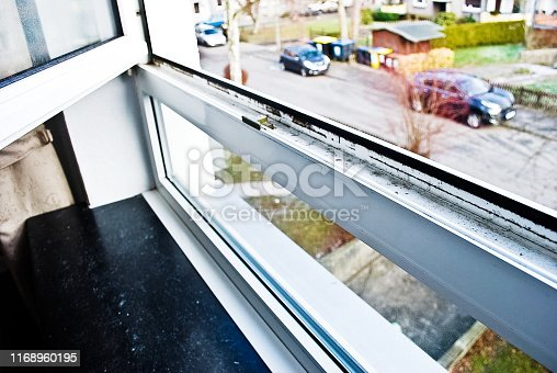 656168432 istock photo Mould colony growing on a house corner wall 1168960195