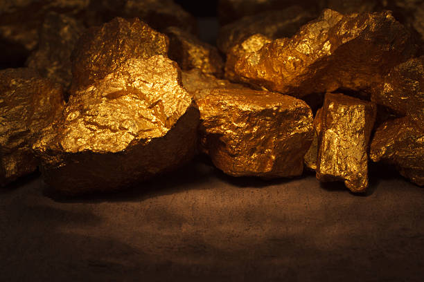 mound of gold - gold mine stock photos and pictures