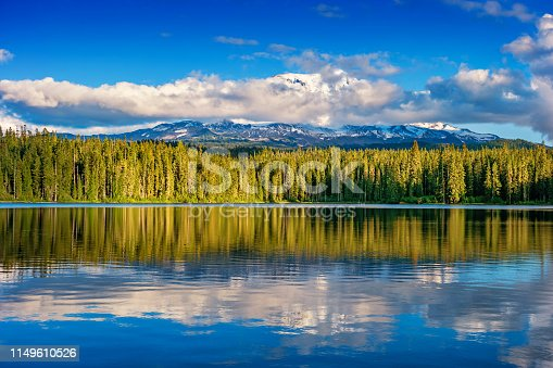 Stock photograph of Mount Adams at pristine and remote Takhlakh Lake, in Washington state, USA on a sunny day.