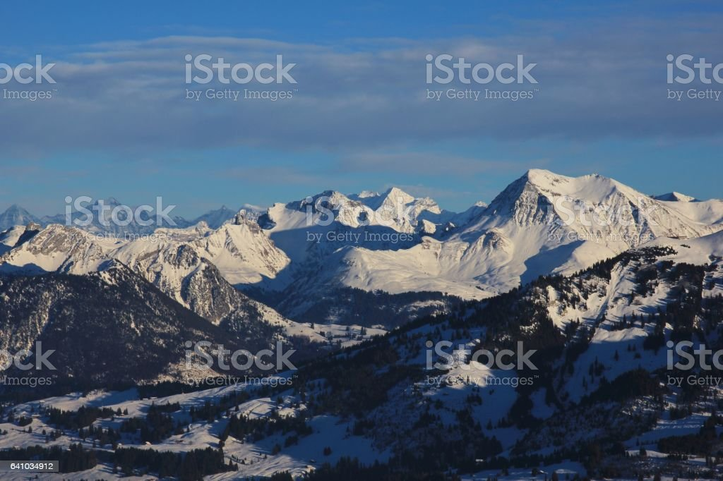 Mount Albristhorn and other snow covered mountains stock photo