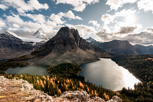 Mount Assiniboine with lake in autumn forest on Niblet peak at provincial park, BC, Canada