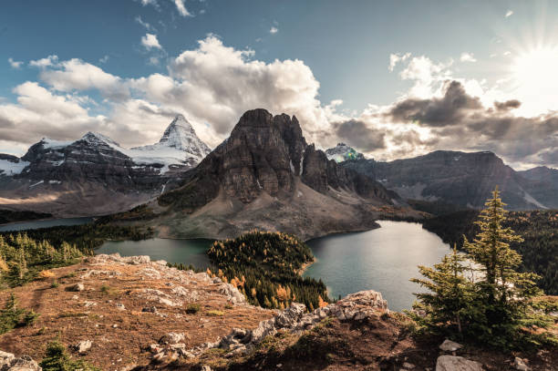 Mount Assiniboine with lake in autumn forest on Nublet peak at provincial park stock photo