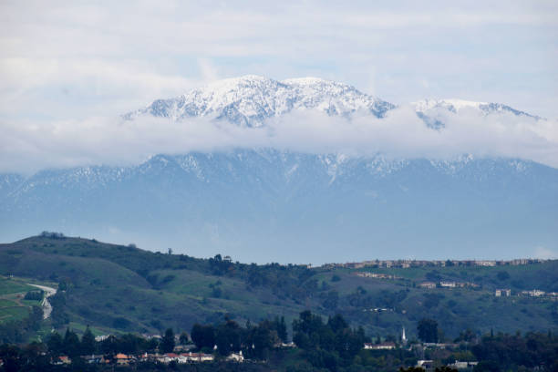 Mount Baldy After a Stormy Day A snapshot of Mount Baldy with its summit partially covered by clouds after a winter storm the day before. mount baldy stock pictures, royalty-free photos & images