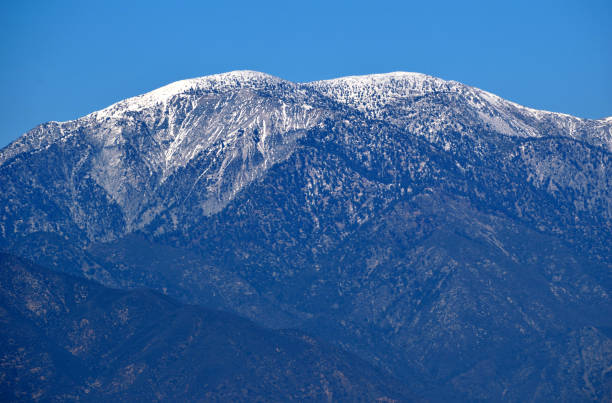 Mount Baldy On A Clear Sunny Day Snow covers the summit of Mount Baldy in the San Gabriel Mountains, as seen from San Bernardino County, CA. mount baldy stock pictures, royalty-free photos & images