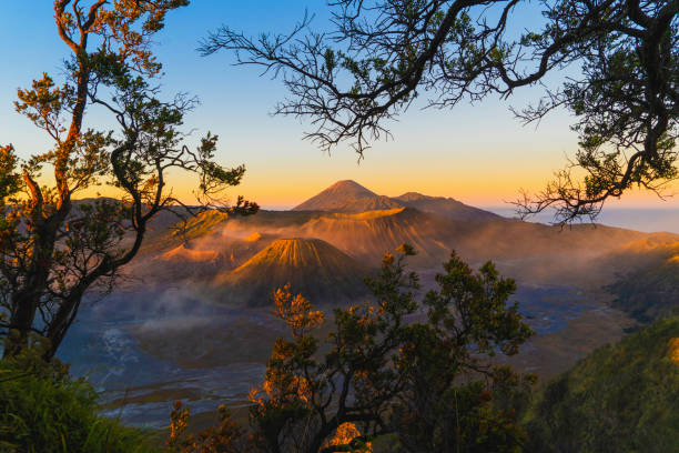 Mount Bromo at sunrise. An active volcano, one of the most visited tourist attractions in east Java from viewpoint, Indonesia. Natural landscape background. stock photo