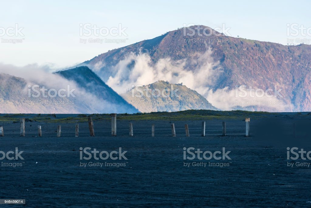 Mount Bromo mountain covered with flowing mist which is a active volcano in the evening, Indonesia stock photo