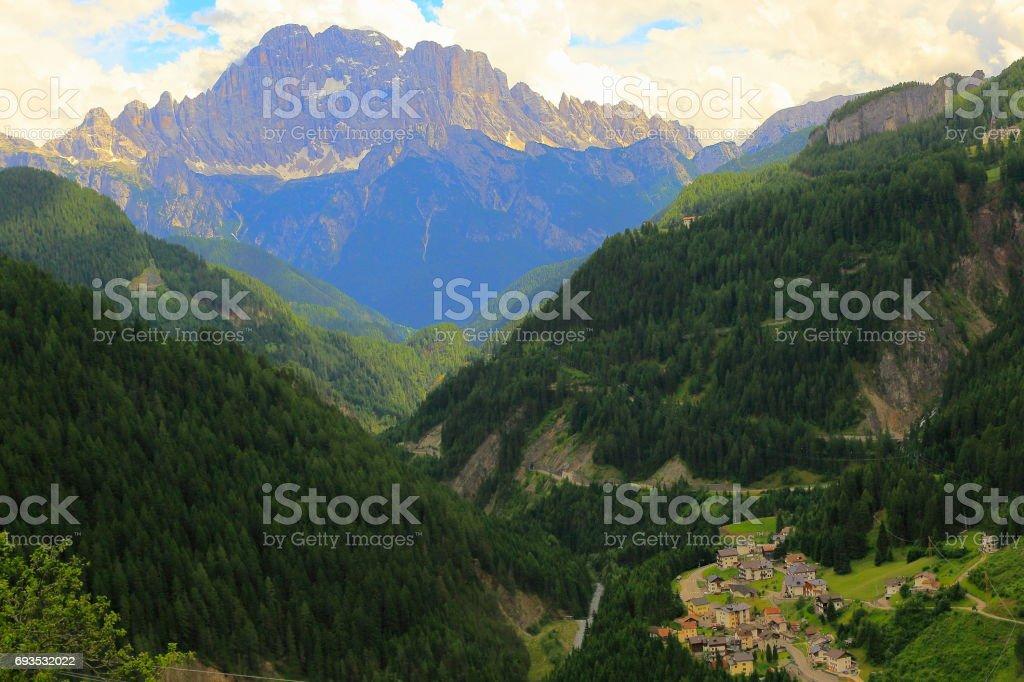 Mount Civetta and Alpine village, Cinque Torri Dolomites, pinnacles mountain range, dramatic and majestic Italy tirol alps stock photo