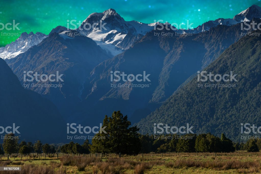 Mount Cook and Lake Matheson New Zealand with milky way stock photo