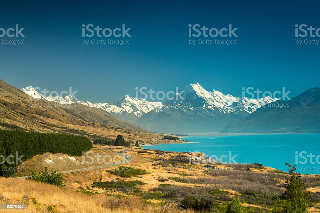 Mount Cook National park, New Zealand In the foreground lake Pukaki. In the background the mountain range of mount Cook and other peaks. 2015 Stock Photo