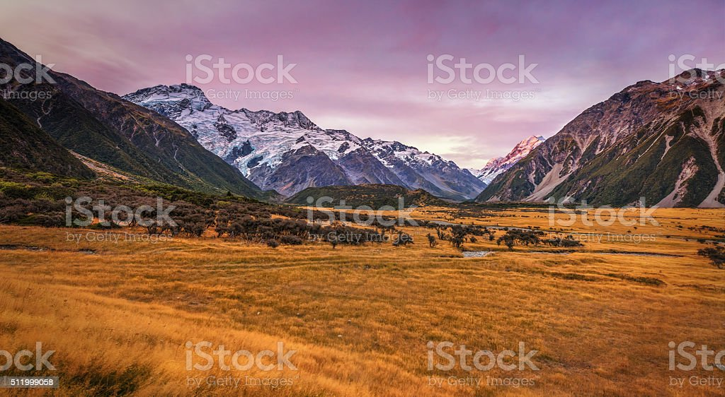 Mount Cook National Park Under Pinky Sky Sunset stock photo