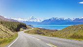 Summer Panorama of the road towards the famous Mount Cook along the turquoise Lake Pukaki. South Island, Canterbury, Mackenzie Basin, Mount Cook, Lake Pukaki, New Zealand