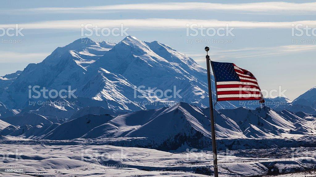 Mount Denali ( McKinley) with usa flag stock photo