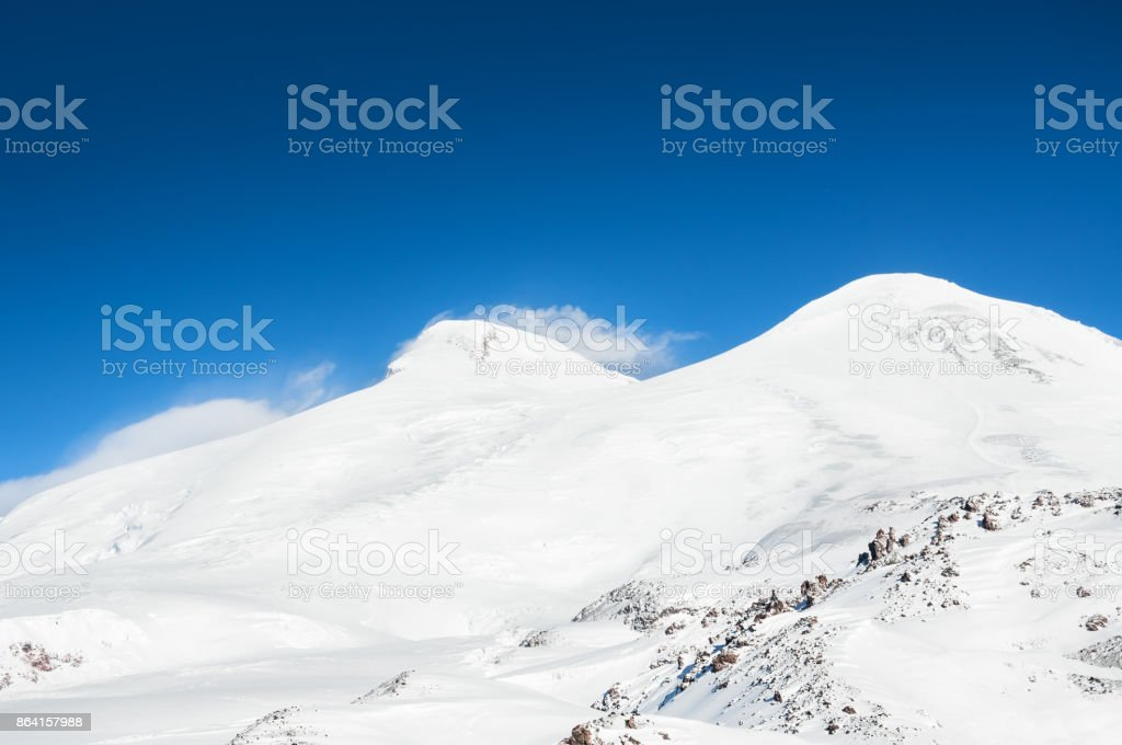 Mount Elbrus against the blue sky royalty-free stock photo
