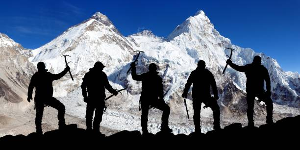 mount everest and lhotse and silhouette of climbers - moraine стоковые фото и изображения