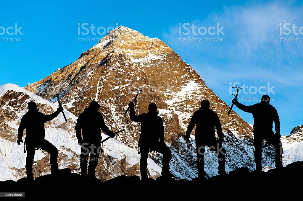Mount Everest and silhouette of climbers stock photo