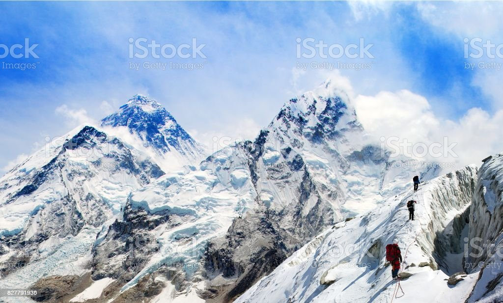 Mount Everest from Kala Patthar with group of climbers stock photo