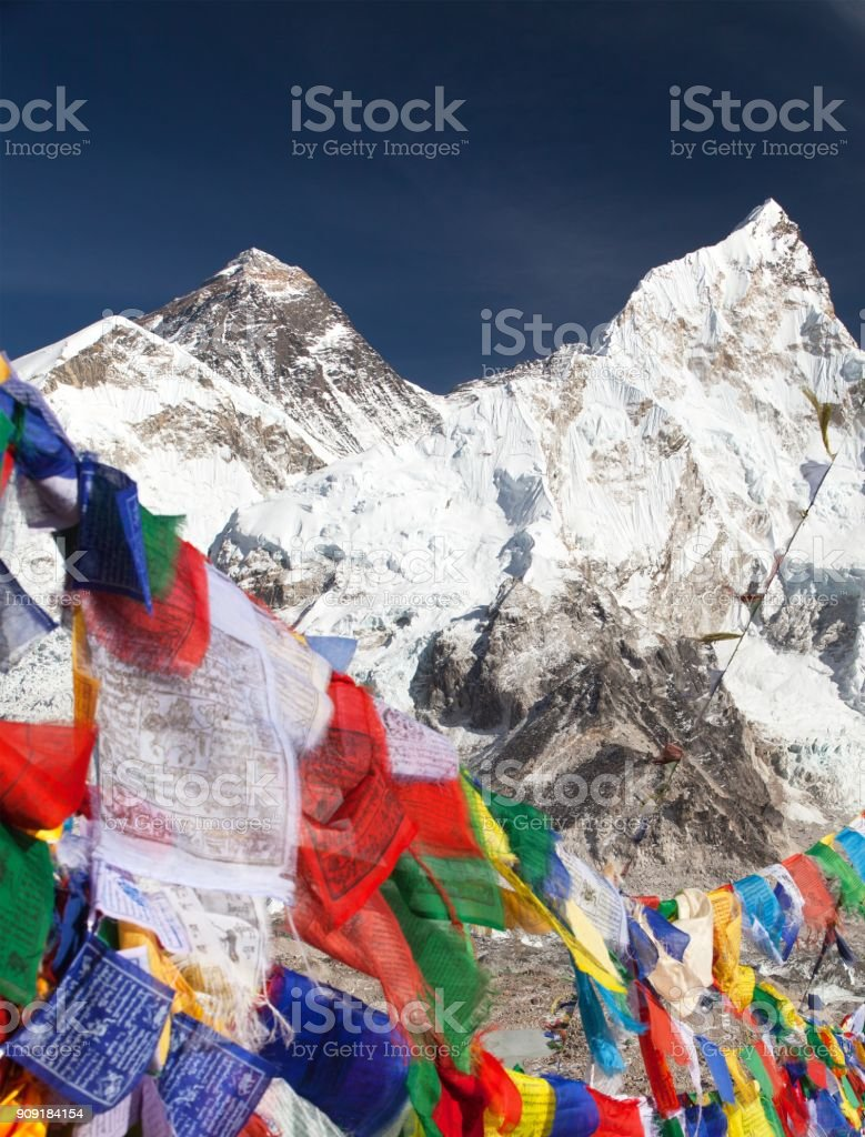 Mount Everest with buddhist prayer flags stock photo