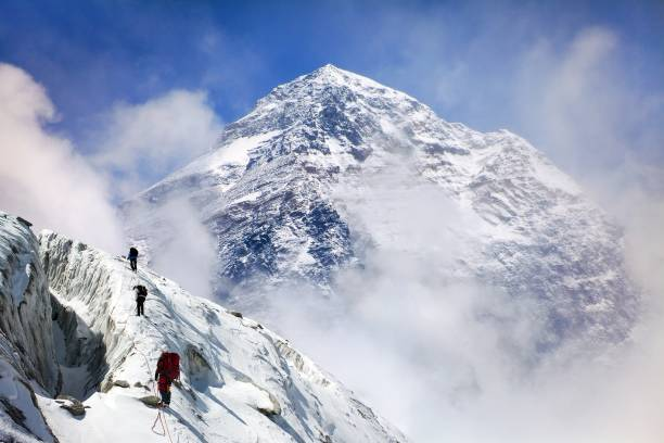 Mount Everest with group of climbers stock photo