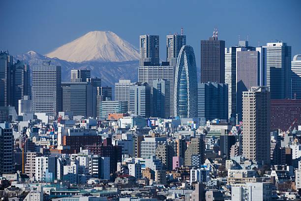mount fuji and the skyscrapers of shinjuku - shinjuku ward stock photos and pictures
