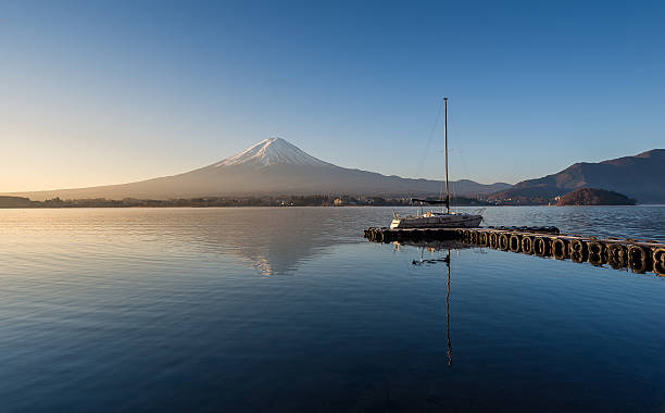 Mount Fuji in the early morning with reflection Mount Fuji in the early morning with reflection on the lake kawaguchiko lake kawaguchi stock pictures, royalty-free photos & images