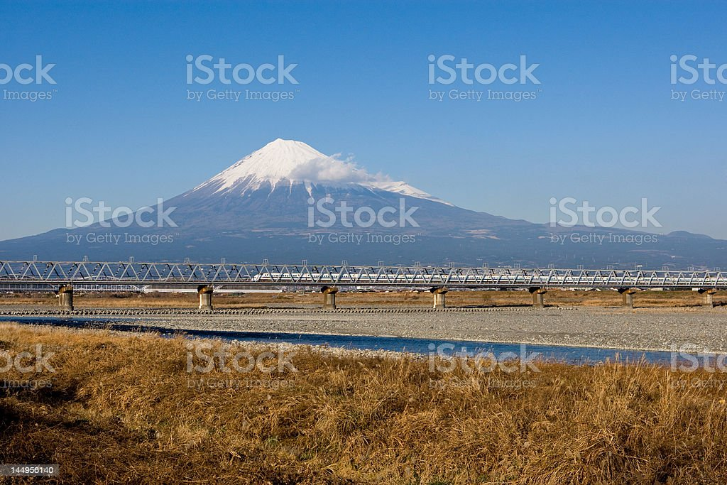 Mount Fuji with a train passing in front stock photo