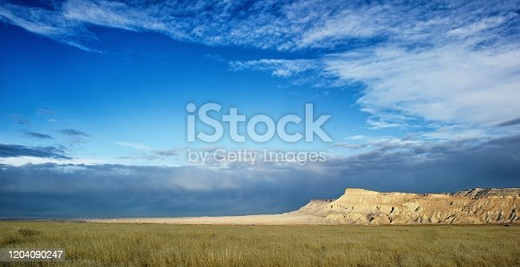 Mount Garfield and the Bookcliffs (Rocky Mountains) in the Grand Valley of Western Colorado with Storm Clouds on the Horizon