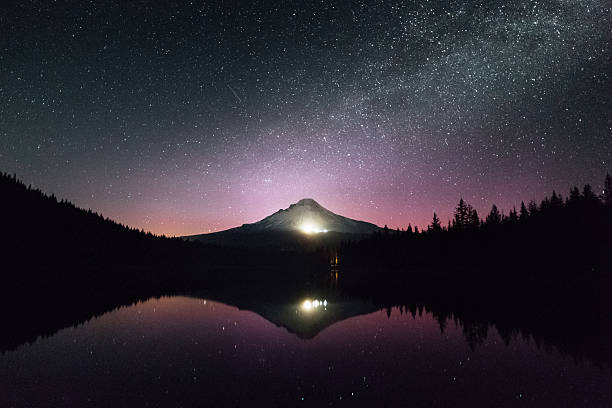 Mount Hood in Oregon reflected in the lake the starry sky above Mount Hood in Oregon. mt hood stock pictures, royalty-free photos & images