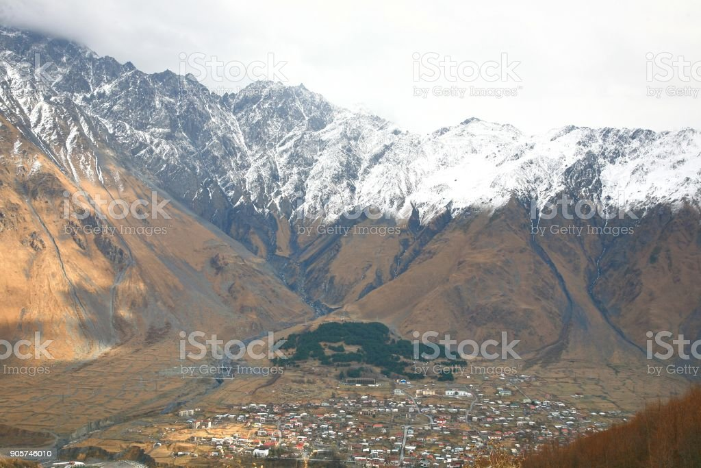 Mount Kazbek is one of the major mountains of the Caucasus located on Kazbegi District in  Georgia stock photo