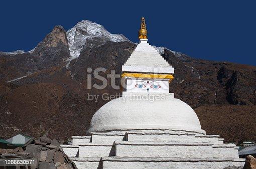 istock Mount Khumbila and white stupa near Khumjung village, Nepal Himalaya 1266630571