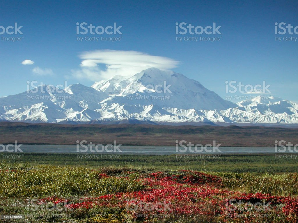 Mount McKinley in the Fall with Clouds and Red Tundra stock photo